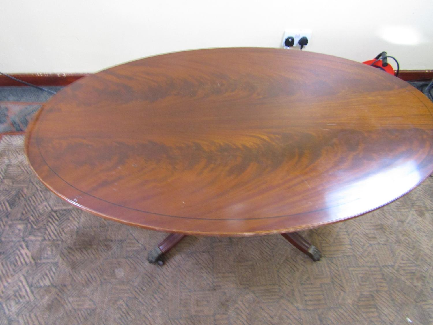 Georgian style furniture. Oval table with lovely metal claw feet and castors  image