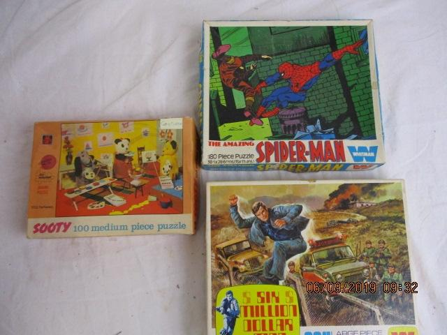 A collection of vintage Television related jigsaws Sooty 100 pcs , Spiderman 80pcs and The six million dollar Man 224 pcs . Great artwork on the boxes .  image