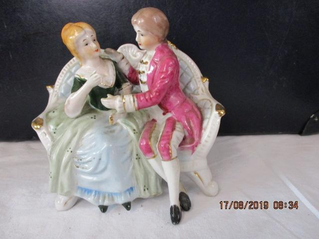 Staffordshire Male and female on a sofa  14 cms high  image
