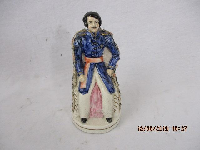 Staffordshire figure of a gentleman sitting down  image