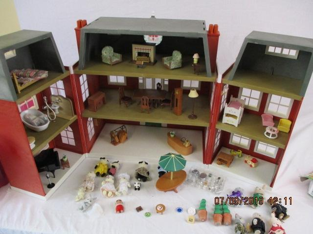 Sylvanian families Regency Hotel,complete with furniture and accessories with 17 figures, comes with box.  image