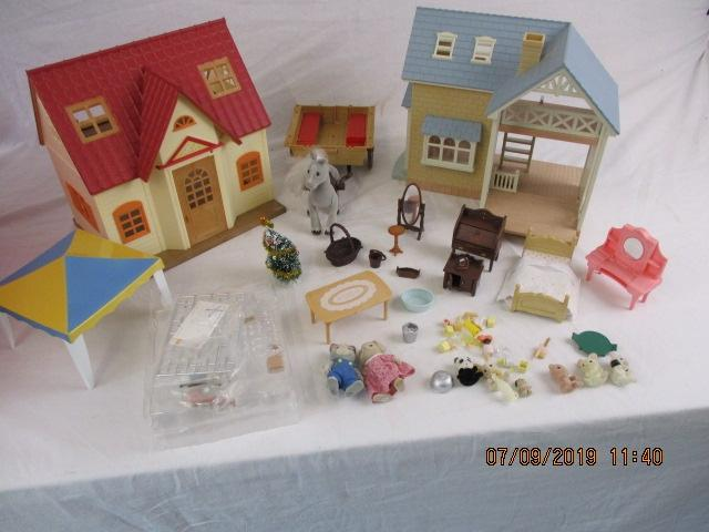 Sylvanian families bundle, comprising of 2 cottages, horse and cart, gazebo and figures  image