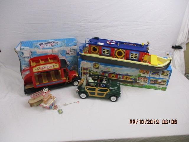 Sylvanian families bundle to include waterside canal boat with box A/F, Green family car, Country bus boxed, plus various figures  image