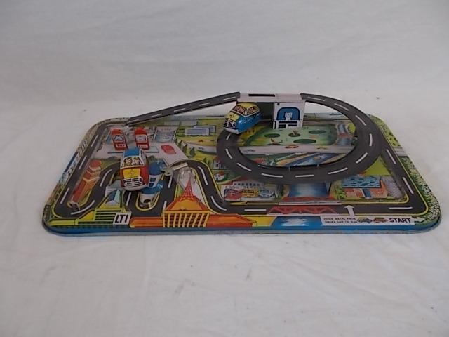 Vintage tin plate racing track with 2 wind up cars,including key.  image