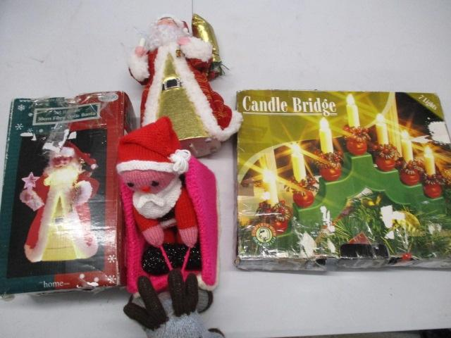 Christmas assortment to include santa, fibre optic santa, knitted santa and sleigh, plus electric candle bridge.  image