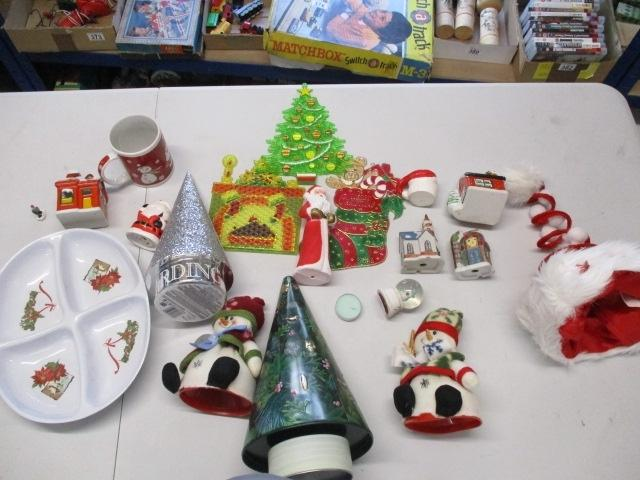 Christmas assortment to include snowman, ornamental christmas trees, santa hat, christmas cottages etc.  image