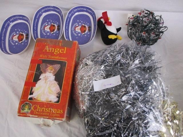 Christmas themed selection comprising of quantity of tinsel, fairy lights, light up fibre optic angel, plus 3 savory dishes.  image