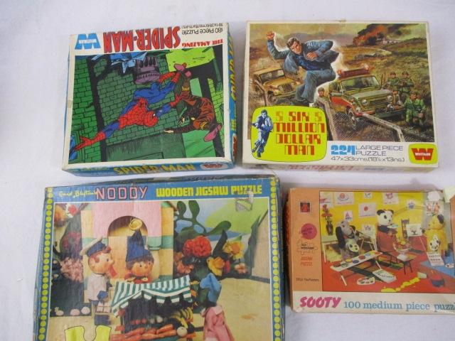 A collection of vintage Television related jigsaws Sooty 100 pcs , Noddy, Spiderman 80pcs and The six million dollar Man 224 pcs . Great artwork on the boxes .  image