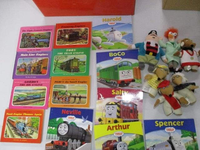 Thomas the tank engine books x 13, plus selection of soft characters to include wombles, Captain Pugwash and Beaker.  image