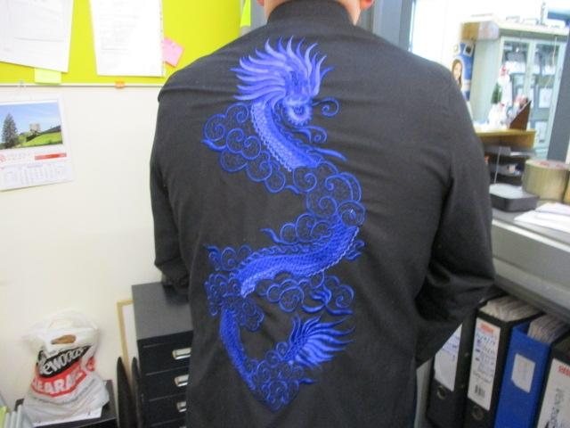 Chinese jacket 100% silk with embroidered dragon detail.  image