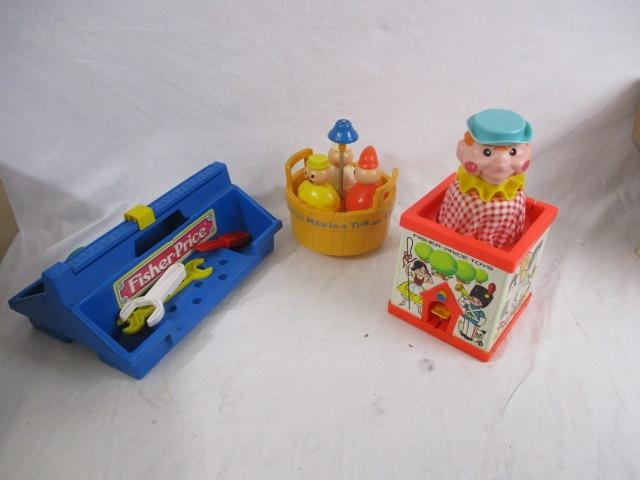 Trio of vintage Fisher price toys to include jack in a box, tool kit and three men in a tub.  image