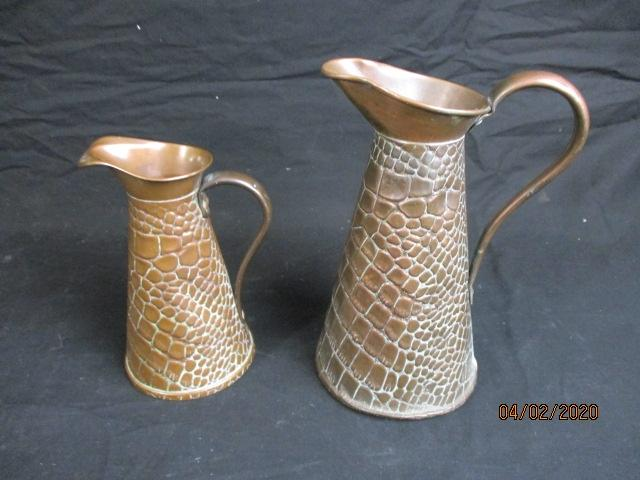 A pair of decorative J.S & S solid copper jugs  image