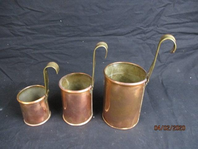 Collection of 3 copper measuring jugs 1/2 pint pint and 2 pint  image