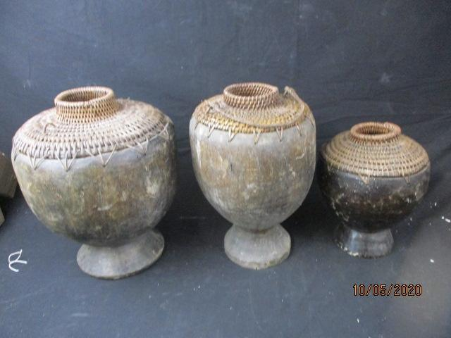 Trio of antique wooden/basket weave African jugs.  image