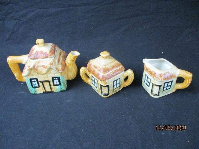 Trio of cottage style teapot, sugar bowl and milk jug.  image
