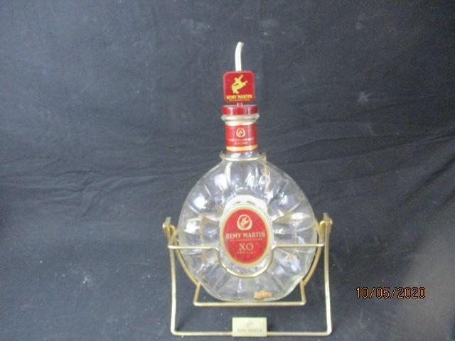Very large Remy Martin XO special fine champagne cognac bottle and stand.  image