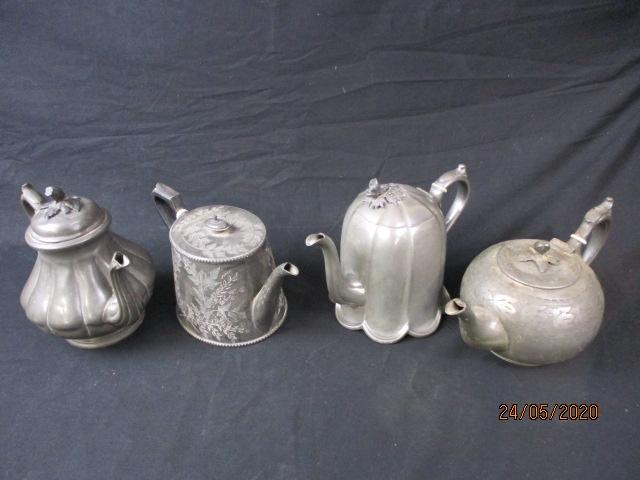 Collection of antique pewter teapots.  image