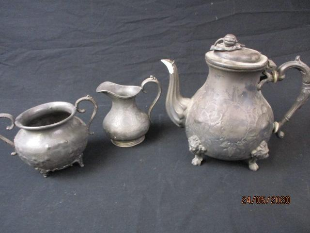 Pewter teapot with sugar bowl and milk jug.  image