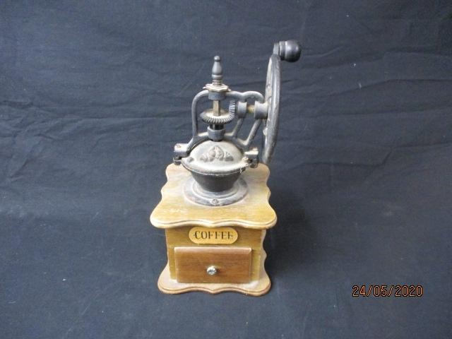Vintage cast iron & wooden coffee grinder.  image