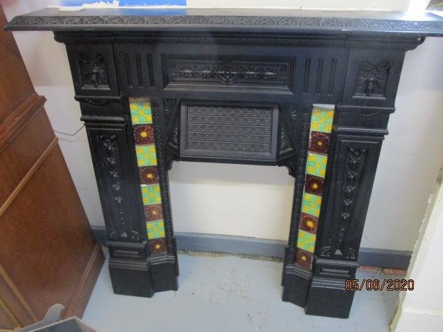 Early 20th Century Cast Iron probably Victorian Fireplace with Grate. 1 Small Chip in one of the tiles.  image