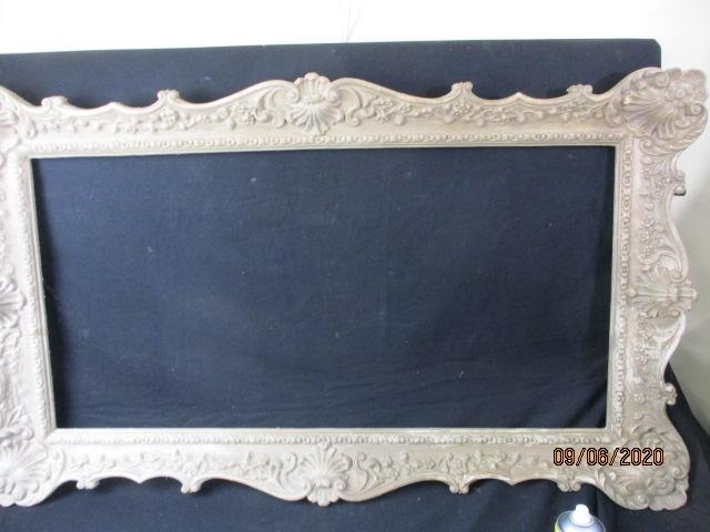 Large resin wept, picture/mirror frame.  image