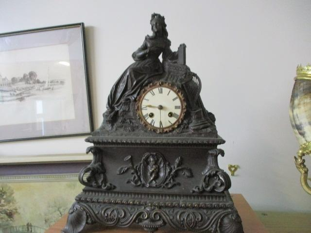 Antique 19th century beautiful detailed bronze mantel clock. (possibly French), 8 day movement striking with a bell  image