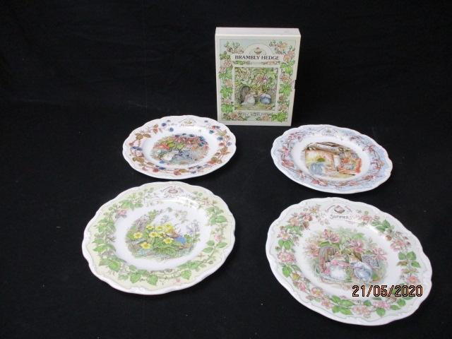 1980's Royal Doulton Brambly hedge four season's plates along with boxed four season's book set.  image