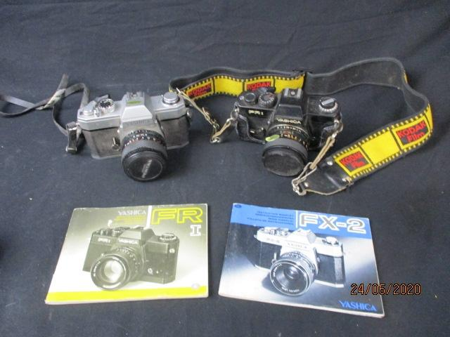 Vintage pair of Yashica cameras FR1 & FX2, with lens and booklets.  image