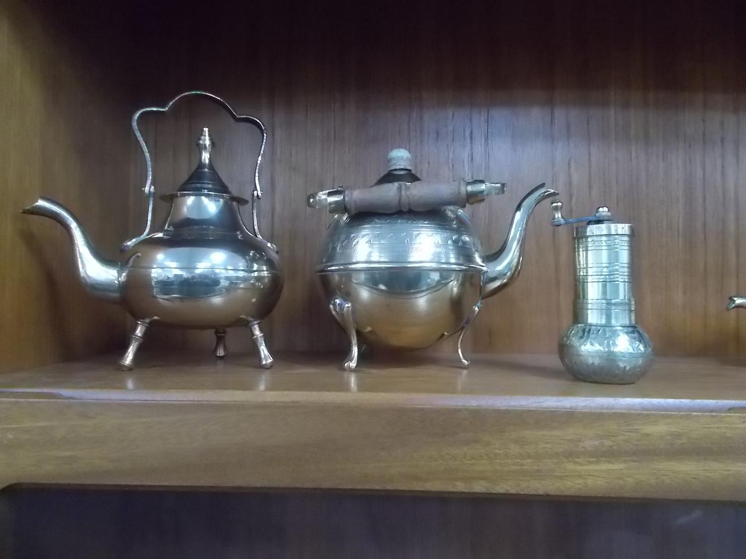 Trio of brass to include Tea & Coffee pots, along with a grinder.  image