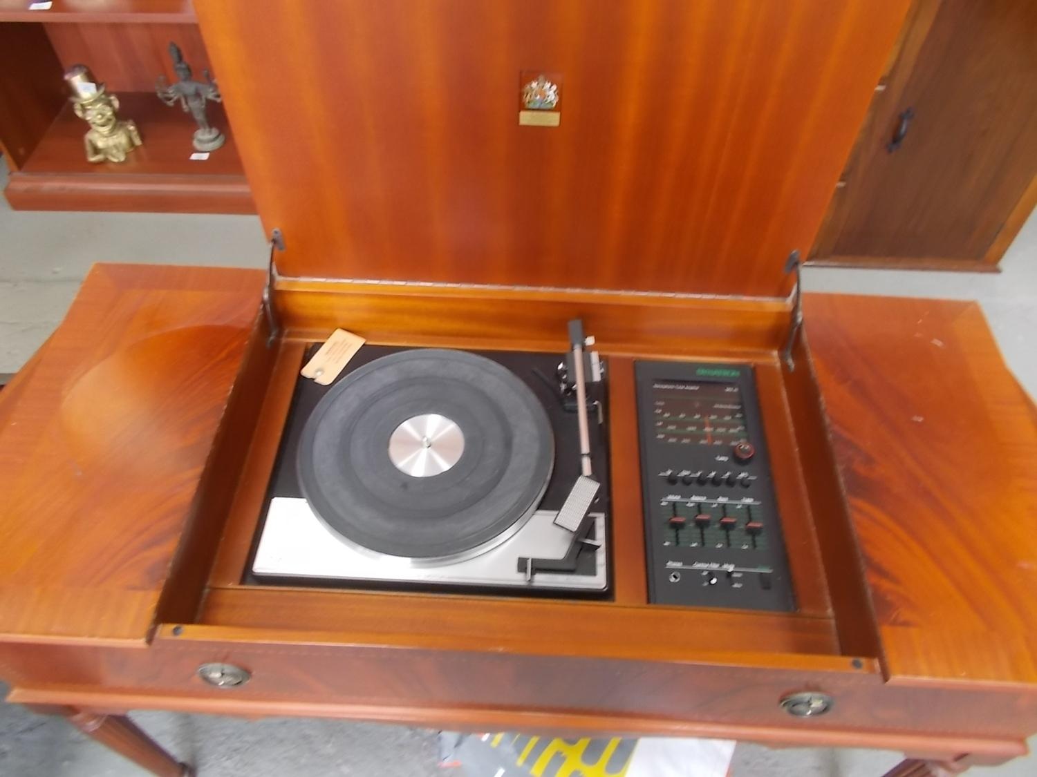 Vintage Garrard radiogram, Garrard deck SP25 MkIV, Dynatron radio. Feathered mahogany case with integrated speakers, lift up lid.  image