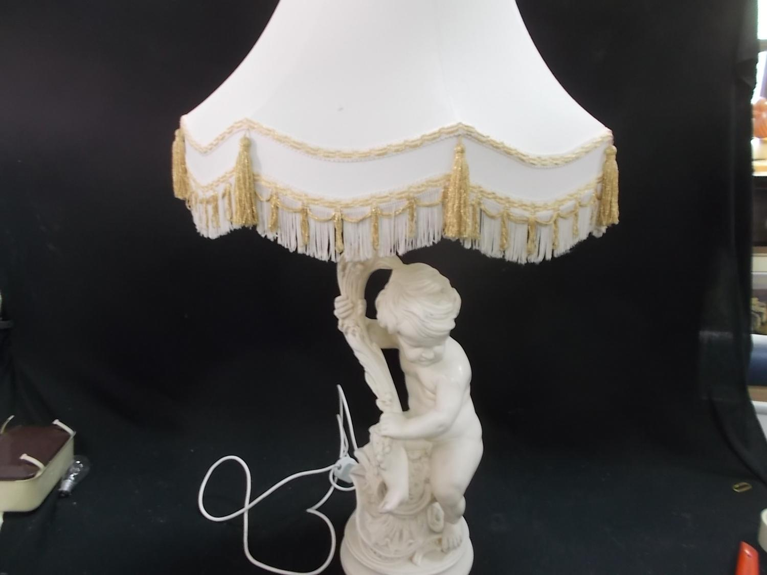 Large vintage cherub table lamp, lovely detailed plaster piece with creme and gold tasselled shade.  image