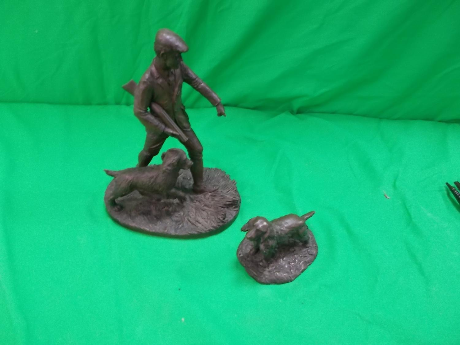Pair of shooting related bronze effect figures.  image