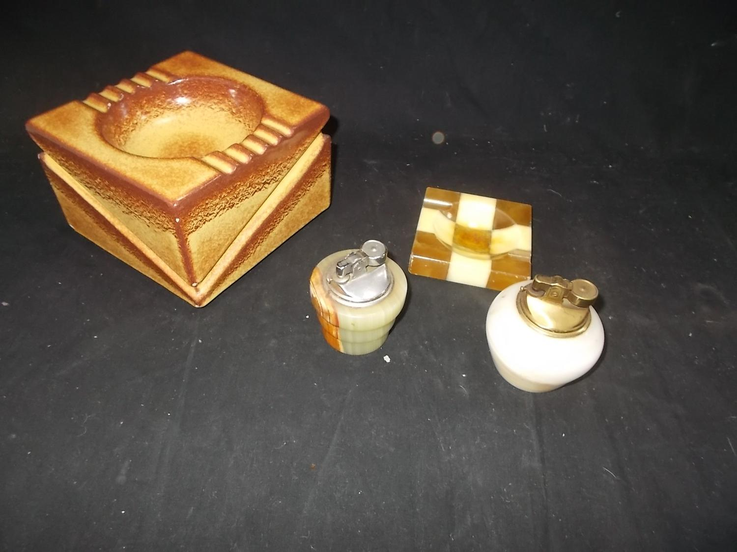 selection of vintage items to include onyx lighters and retro ashtrays.  image