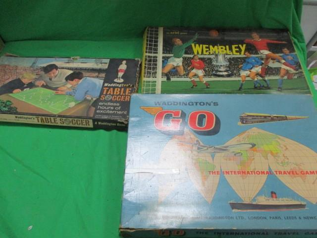 3x Board games, table soccer, the international travel game and the thrilling cup tie game  image