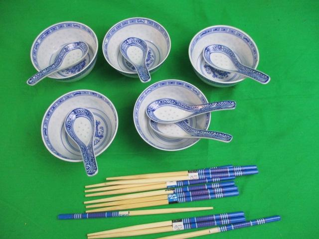 A set of Chinese bowls with chopsticks  image