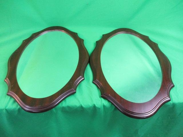 Pair of Mahogany style oval hall mirrors.  image