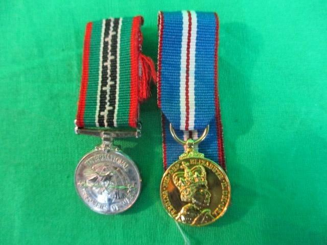 A pair of miniature medals to include a Prisoner of War medal  image